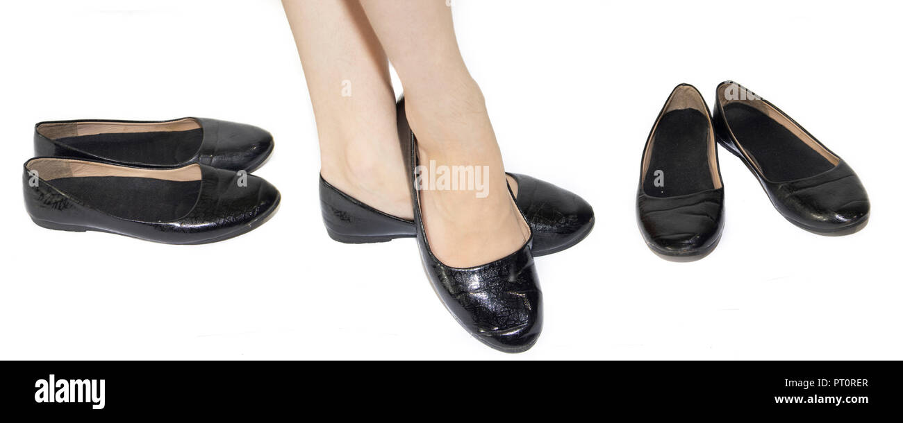 Black ballet flats on female legs on a