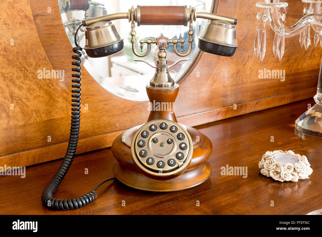 Vintage Telephone Decoration On A Wooden Table Stock Photo
