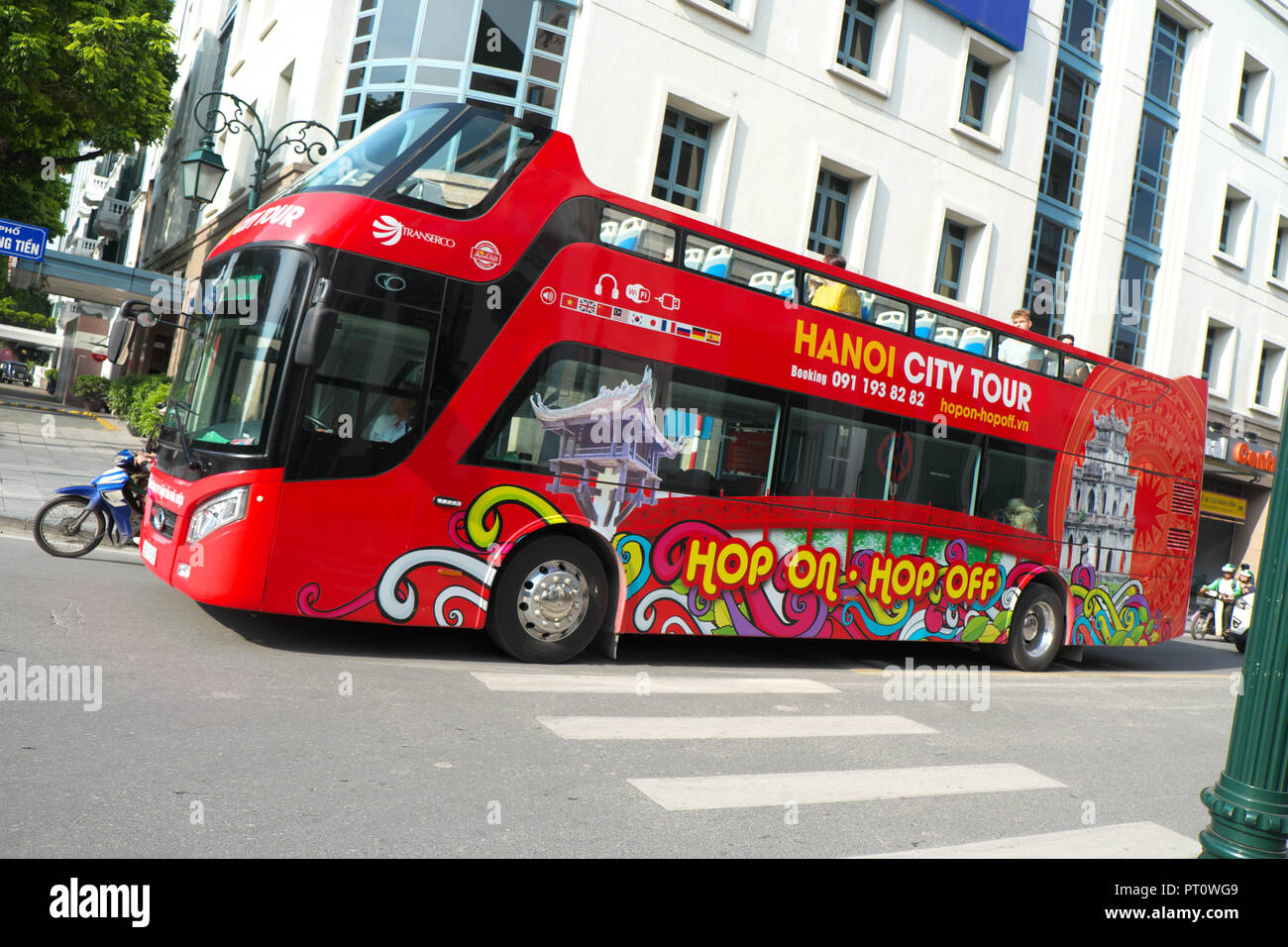 Hanoi Vietnam modern open top double decker tour sightseeing bus in the Old Quarter August 2018 - Stock Image