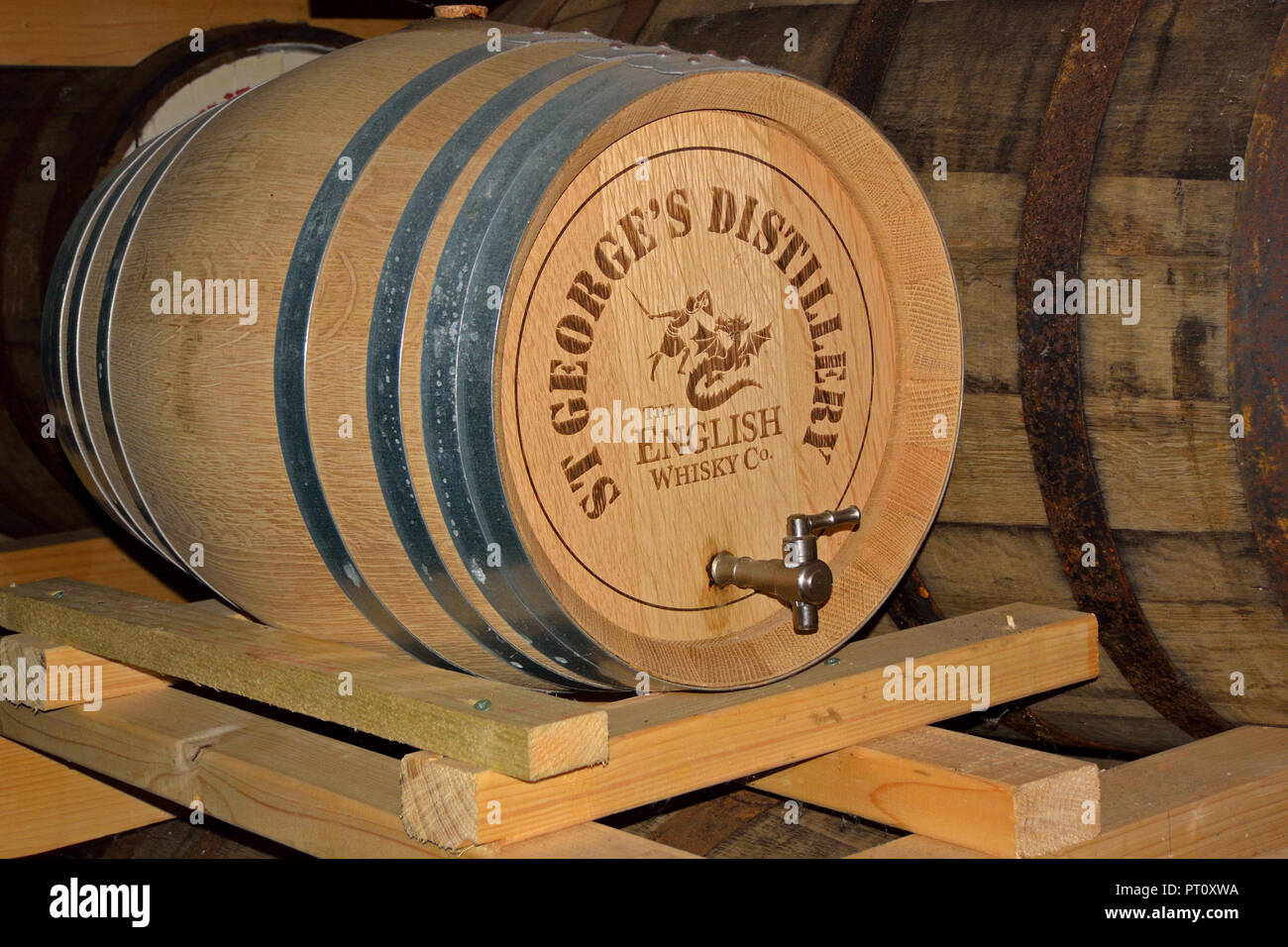 Oak cask of single malt English Whisky maturing in the warehouse at St George's Distillery, Roudham, Norfolk, UK. Stock Photo