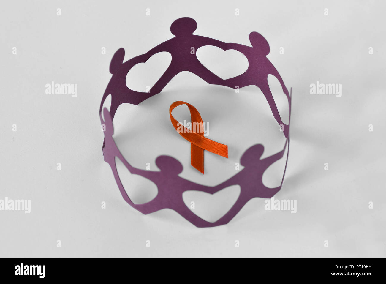 Paper people in a circle around orange ribbon on white background - Concept of leukemia awareness, kidney cancer association, multiple sclerosis and a - Stock Image