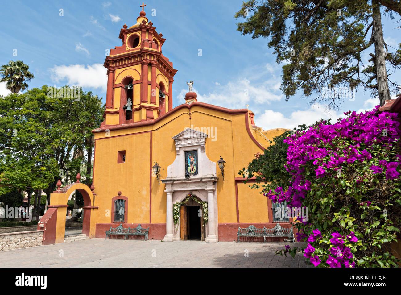 The Parroquia San Sebastian Church With Flowering Bougainvillea In