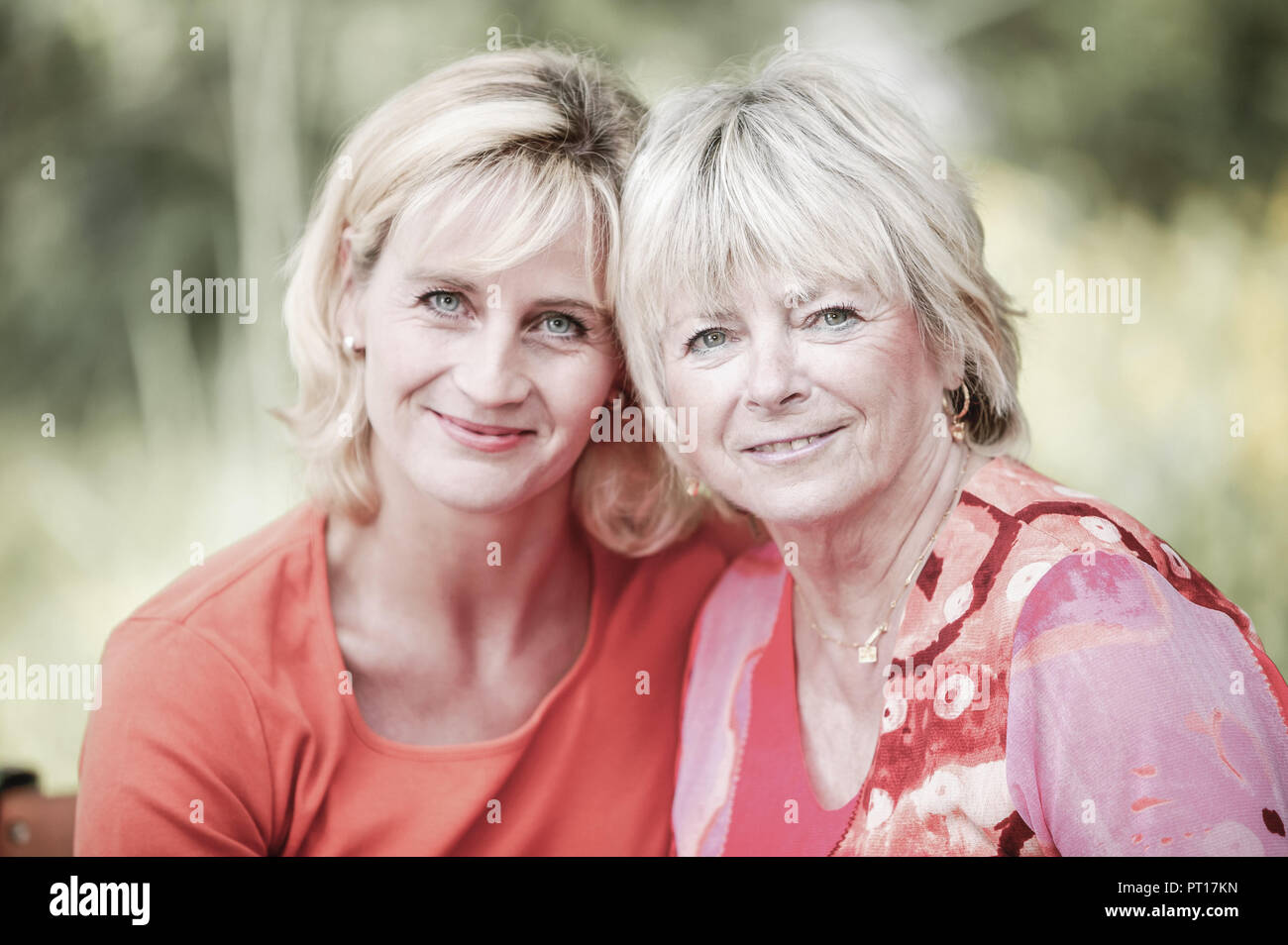 grown-up daughter with mother in garden (model-released) Stock Photo