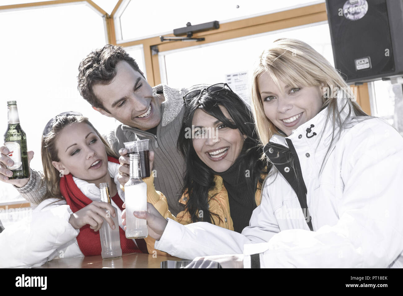 young people at apres ski in winter holiday (model-released) - Stock Image