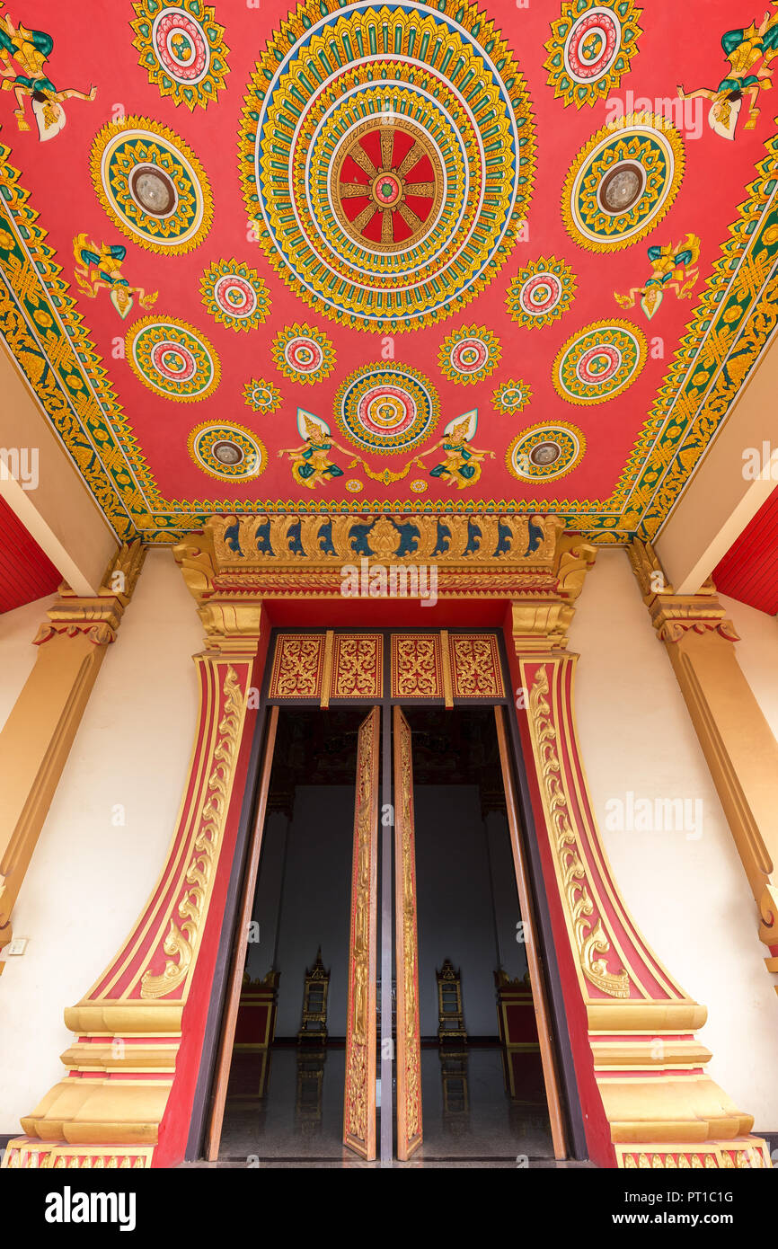 Ornate entrance to the Hor Dhammasabha Buddhist convention hall of Wat That Luang Neau Temple in Vientiane, Laos. - Stock Image