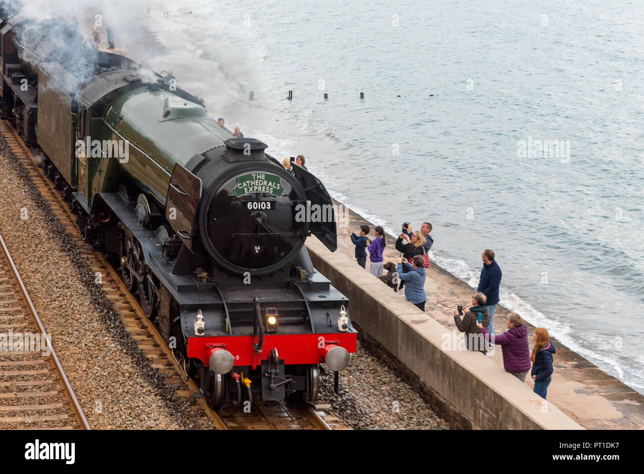 DAWLISH, DEVON, UK - 4OCT2018: The Flying Scotsman on an evening run from Taunton to Plymouth. Seen here passing along the sea wall at Dawlish. - Stock Image
