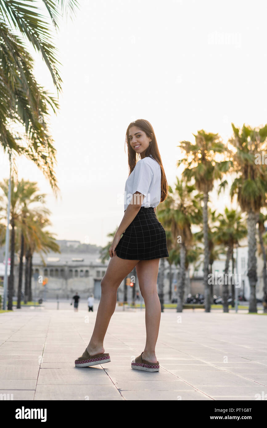 750a0b3a7 Portrait of a confident young woman in the city, wearing mini skirt - Stock  Image