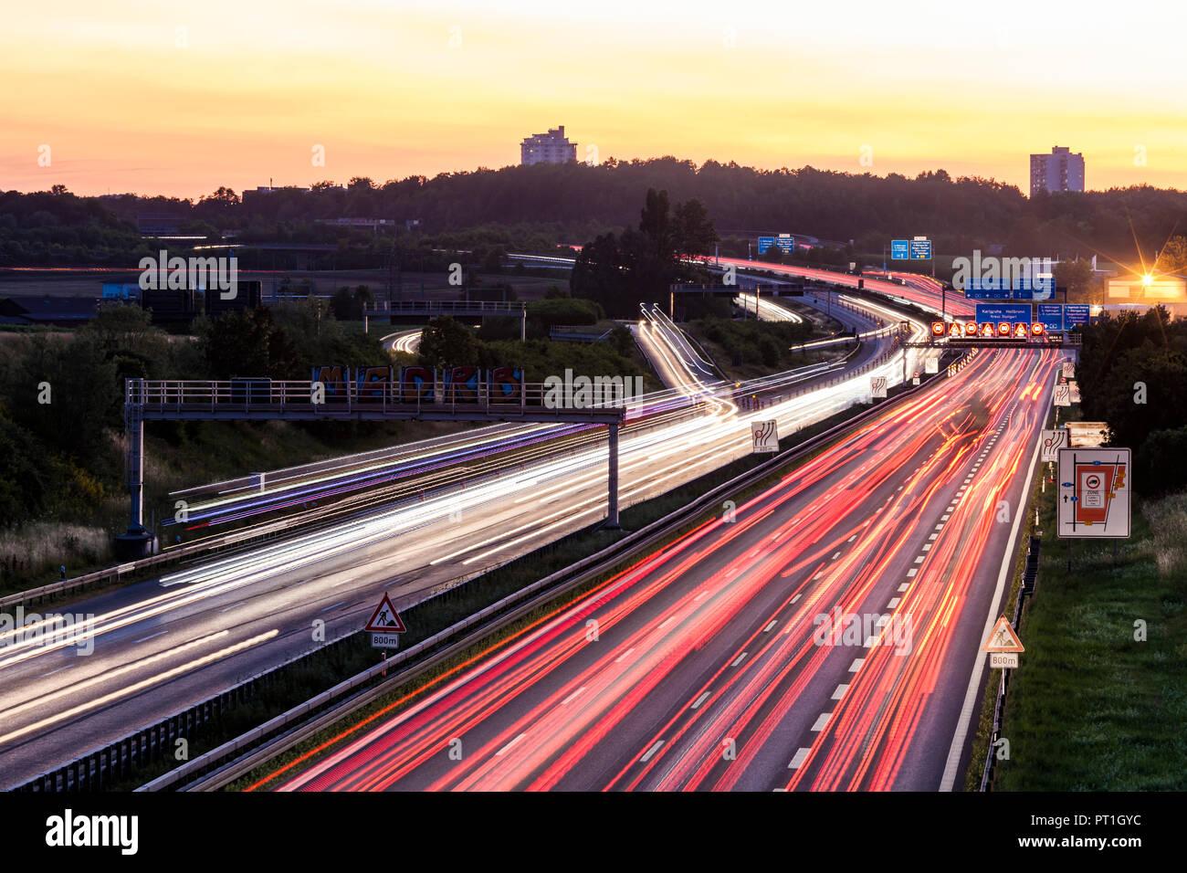 Germany, Baden-Wuerttemberg, Stuttgart, Autobahn A8 in the evening, light trails - Stock Image