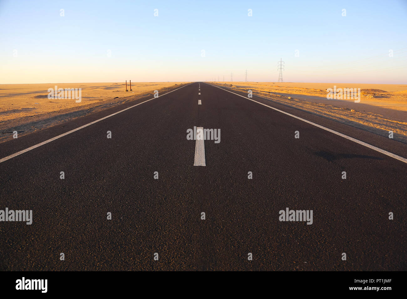 A view from the middle of the deserted road in the Sahara Desert, Egypt, Africa - Stock Image