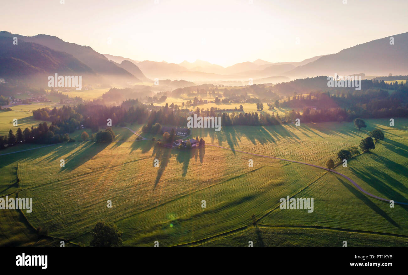Austria, Tyrol, Kaiserwinkl, Aerial view at sunrise - Stock Image