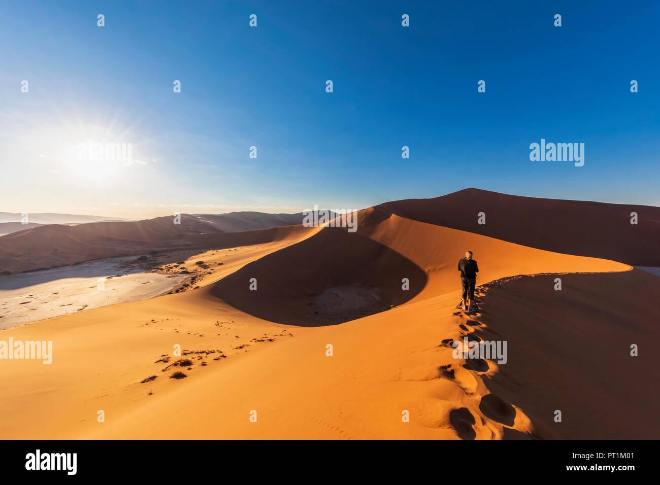 Africa, Namibia, Namib desert, Naukluft National Park, woman on sand dune 'Big Daddy' - Stock Image