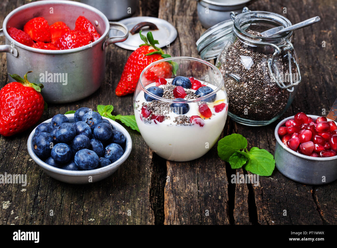 Yogurt with berries and chia seeds, superfood - Stock Image