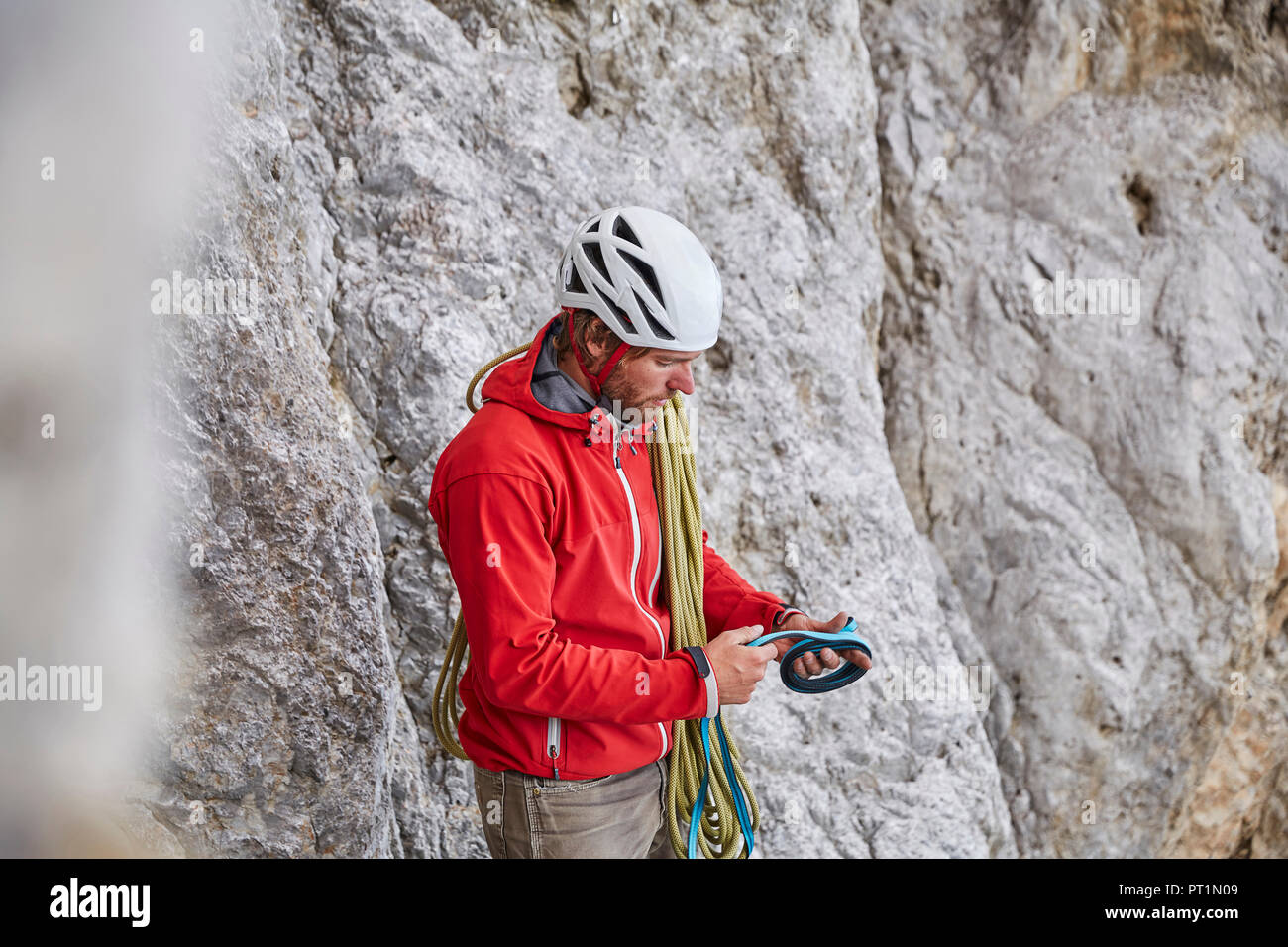 Man with rope and climbing equipment - Stock Image