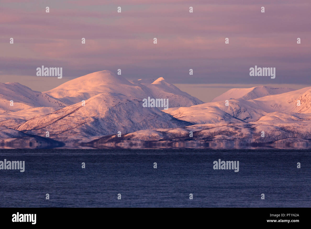 Fata Morgana mirage on a fjord near Tromso with Senja island mountains in background, Tromso, Troms, Norway, Europe Stock Photo