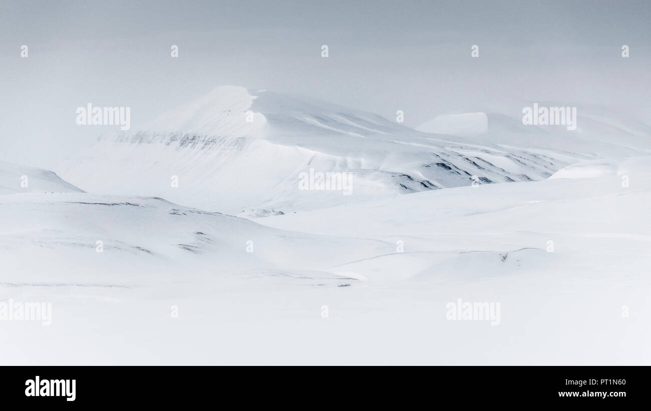Spitsbergen mountains after sunset in late winter, Svalbard, Norway - Stock Image