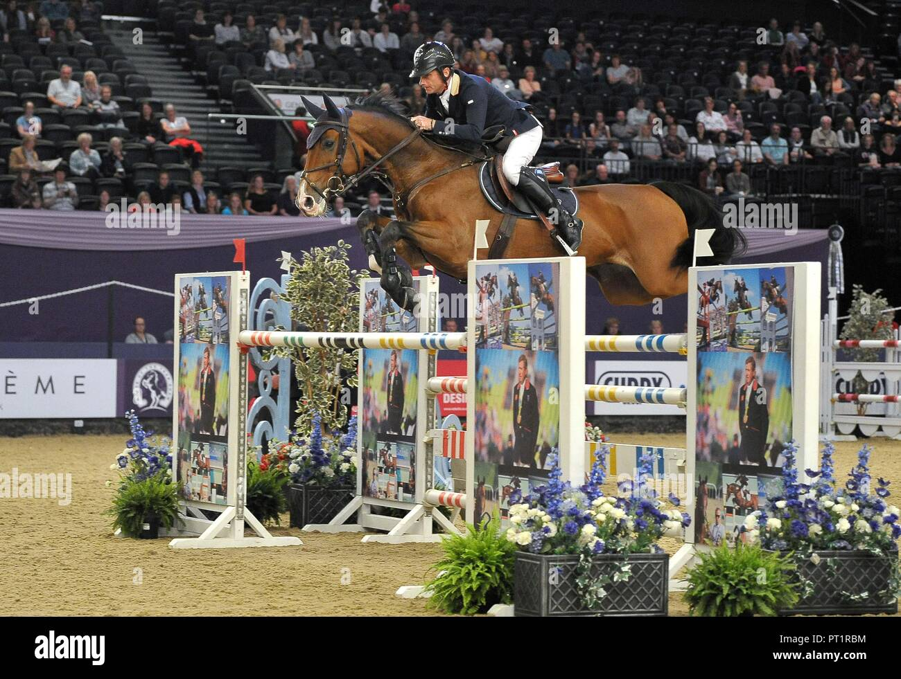 """Birmingham, UK. 5th October, 2018. Denis Lynch (IRL) riding """"Caruso"""". International showjumping. Grandstand welcome stakes. Horse of the year show (HOYS). National Exhibition Centre (NEC). Birmingham. UK. 05/10/2018. Credit: Sport In Pictures/Alamy Live News Stock Photo"""