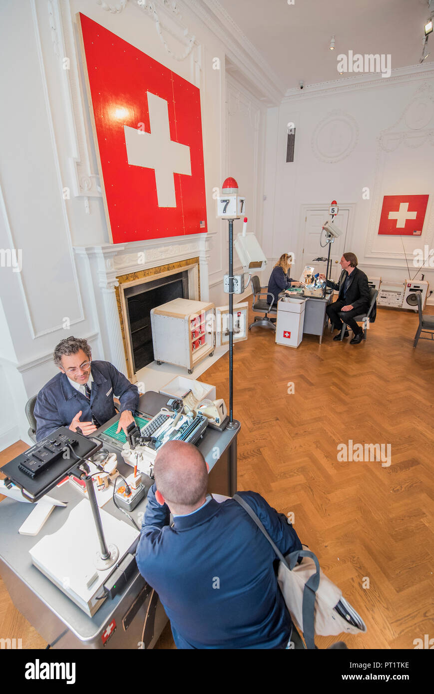 24h live performance of Swiss Passport Office by American artist Tom Sachs  at Galerie Thaddaeus Ropac London . Visitors can be issued with a Tom Sachs  ... 1f84bd7136d1