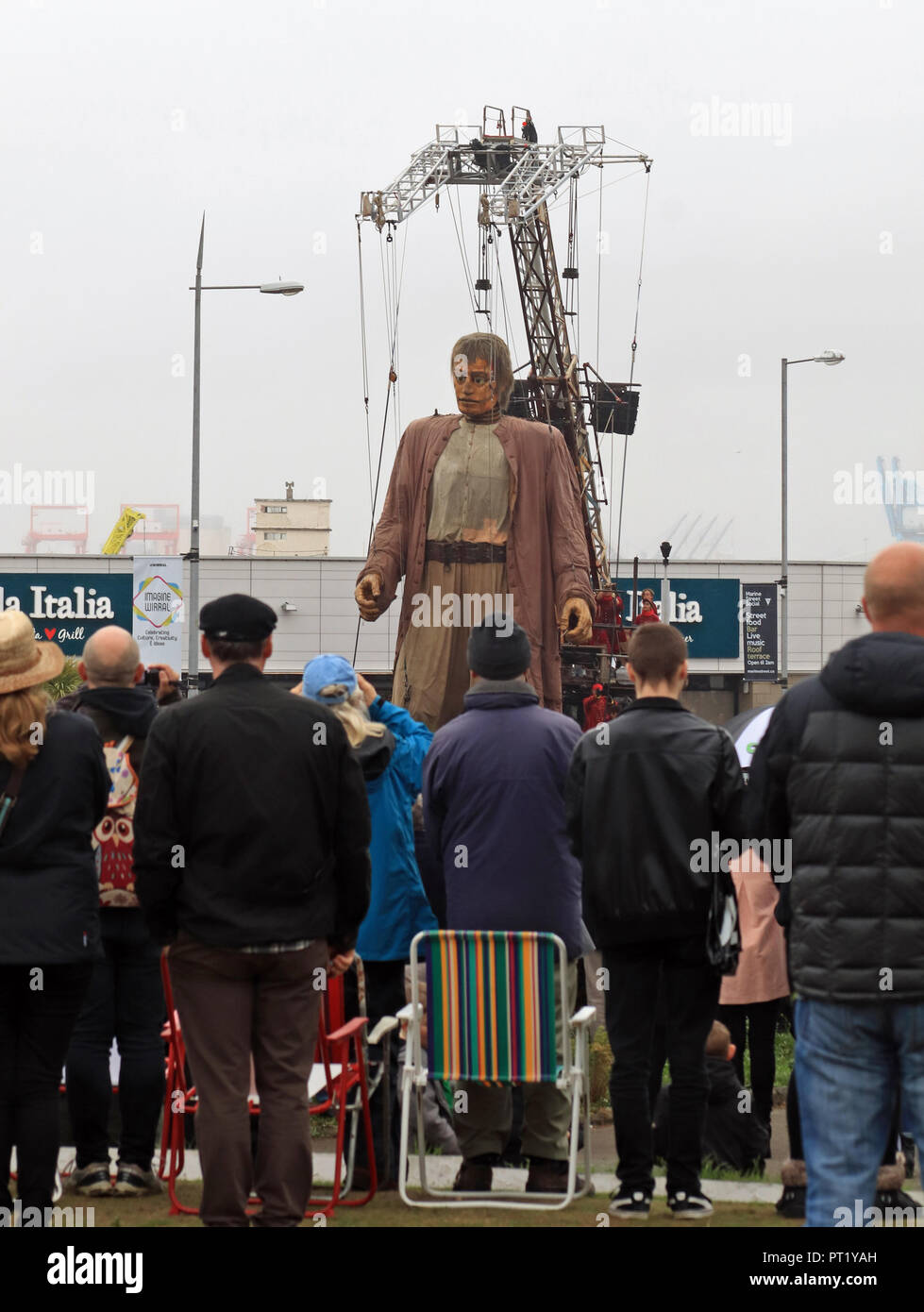 Merseyside, UK. 5th October 2018. New Brighton, Wirral, Merseyside. 5th October 2018.  On a gloomy autumn morning The Giant makes his way along the Marine Drive at New Brighton on The Wirral brings the crowds to their feet. Credit: Colin Wareing/Alamy Live News Stock Photo