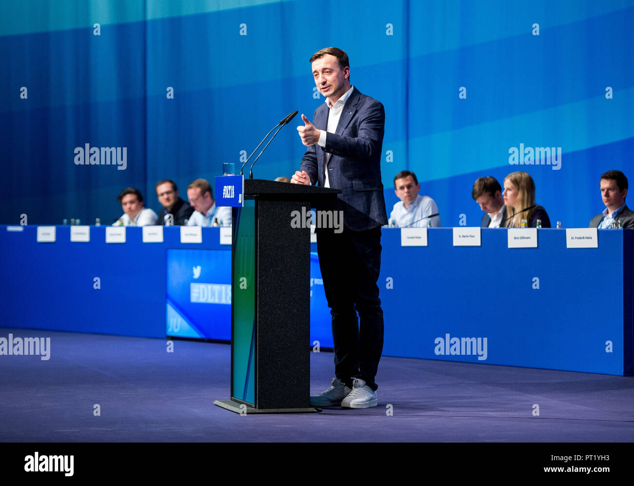 05 October 2018, Schleswig-Holstein, Kiel: Paul Ziemiak, Federal Chairman of the Junge Union Deutschland (JU), speaking during the Germany Day of the Junge Union (JU). Around 1000 delegates and guests met at the meeting of the youth organisation to discuss how Germany can remain stable and economically successful in 2030. Photo: Daniel Bockwoldt/dpa Stock Photo