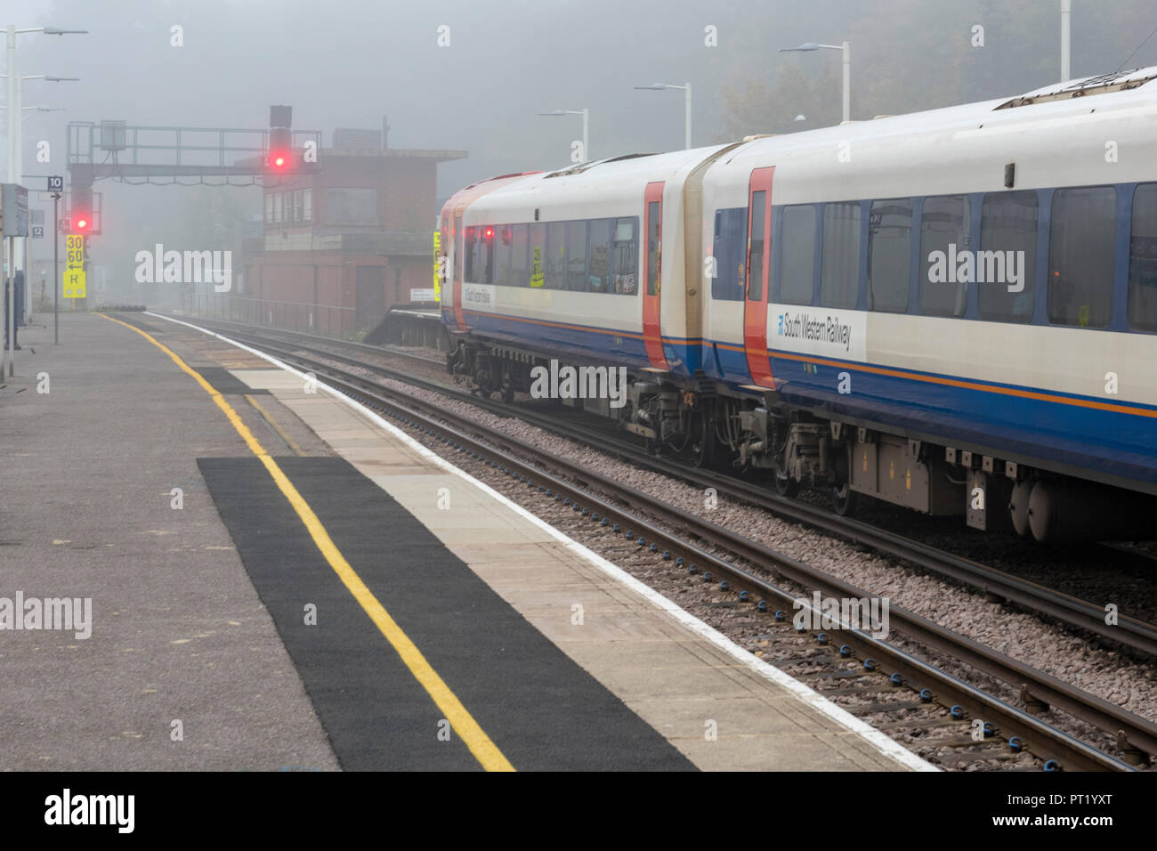London, UK. 5th October 2018. Southwestern railway trains on a foggy moring at Southamton railway station on the first day of further industrial action by Guards in reaction to no deal with the train operating company on the future role of Guards on trains. Traincrew striking and managers running trains providing a greatly reduced service for the travelling public and rail season ticket holders commuting into London Waterloo. Credit: Steve Hawkins Photography/Alamy Live News - Stock Image