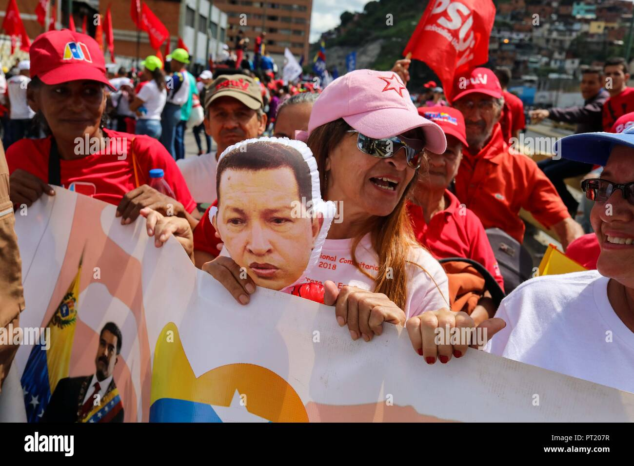 Caracas, Venezuela. 05th Oct, 2018. Officialist sympathizers march in Caracas, Venezuela, 05 October 2018. Thousands of chavists marched 'for the peace' at the capital as they assure the country is being hounded by 'agents of the imperialism' and showed their support for President Nicolas Maduro. Credit: Cristian Hernandez/EFE/Alamy Live News - Stock Image