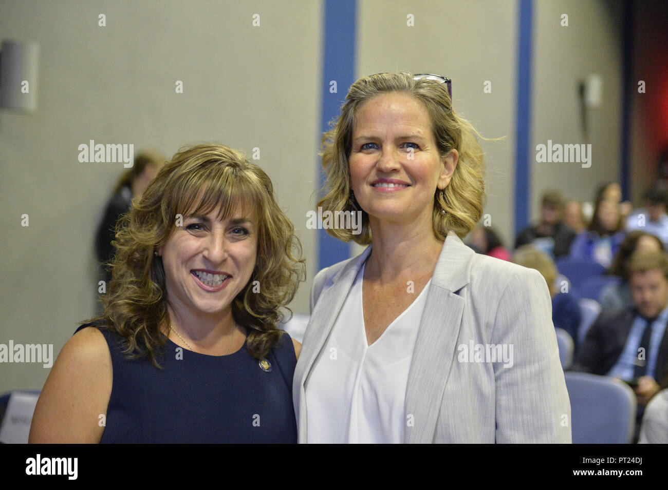 Hempstead, New York, USA. 5th Oct, 2018. L-R, Democrats New York Assemblywoman District 9 CHRISTINE PELLEGRINO and Nassau County Executive LAURA CURRAN pose before start of U.S. Sen. Gillibrand's Town Hall Meeting at Hofstra University on Long Island. Credit: Ann Parry/ZUMA Wire/Alamy Live News - Stock Image