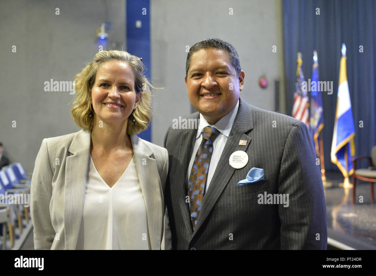 Hempstead, New York, USA. 5th Oct, 2018. L-R, Democrats Nassau County Executive LAURA CURRAN and JUAN VIDES, candidate for NYS 20th Assembly District, pose before start of U.S. Sen. Gillibrand's Town Hall Meeting at Hofstra University on Long Island. Credit: Ann Parry/ZUMA Wire/Alamy Live News - Stock Image