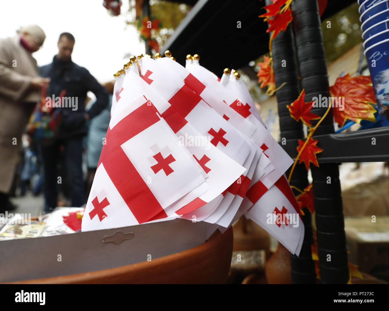 Moscow, Russia. 06th Oct, 2018. MOSCOW, RUSSIA - OCTOBER 6, 2018: Georgian flags at the annual 2018 Tbilisoba Festival of Georgian Culture at the Moscow Hermitage Garden. Artyom Geodakyan/TASS Credit: ITAR-TASS News Agency/Alamy Live News Stock Photo
