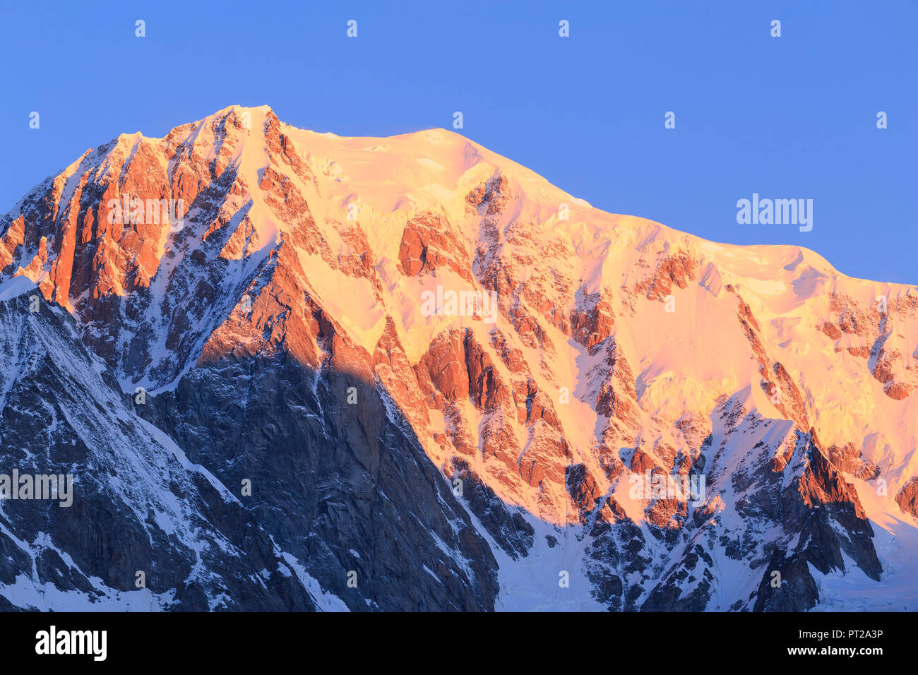 Mont Blanc illuminated by the rising sun, Ferret Valley, Courmayeur, Aosta Valley, Italy, Europe - Stock Image