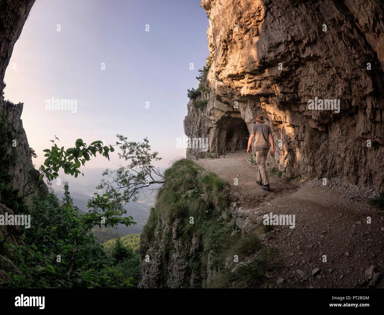 Italy, Veneto, Strada delle 52 Gallerie, hiker on the move - Stock Image