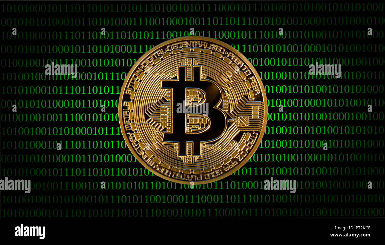 Symbolic image of digital currency, golden physical coin Bitcoin in front of digital binary code - Stock Image