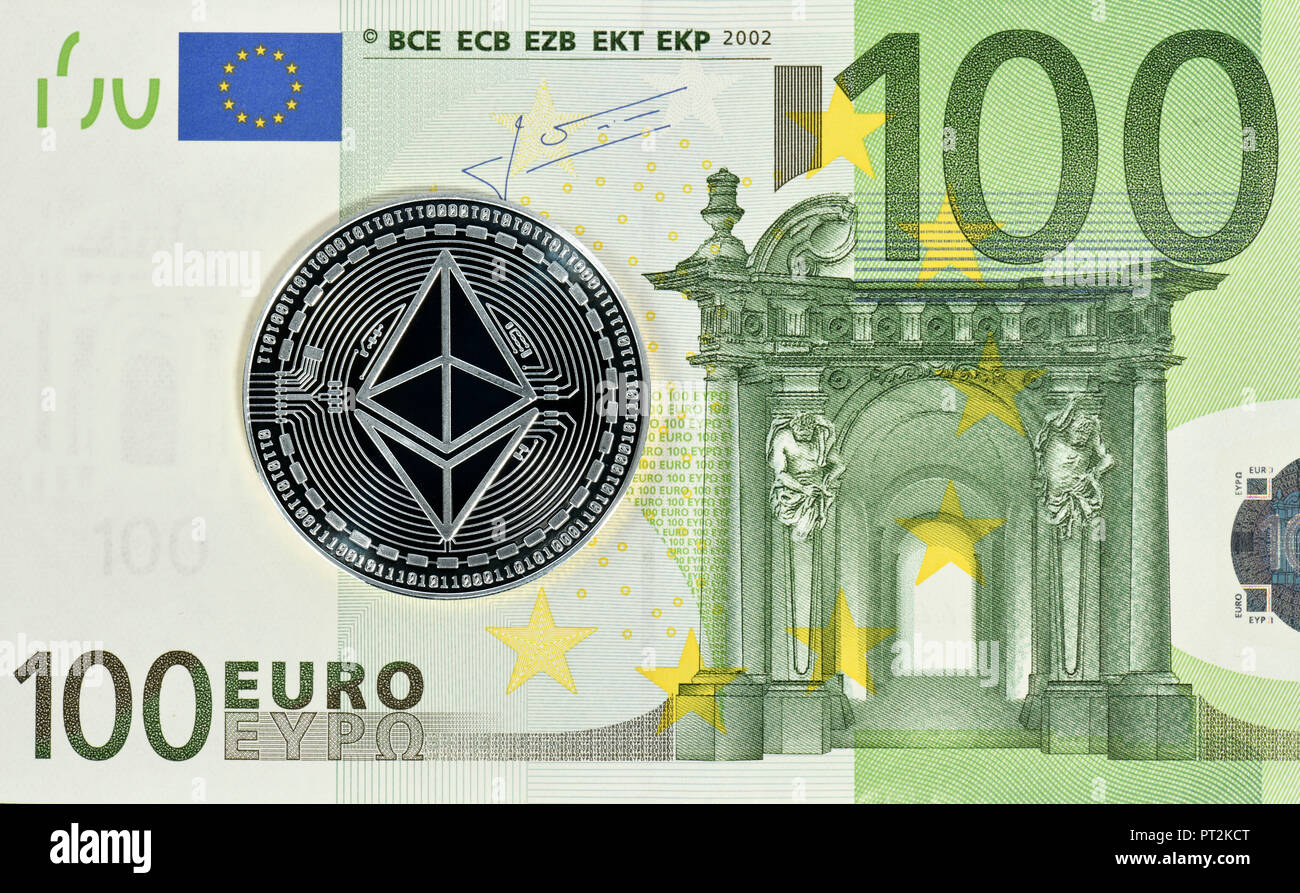 Symbolic image of digital currency, silver physical coin Ethereum on 100 EURO banknote - Stock Image