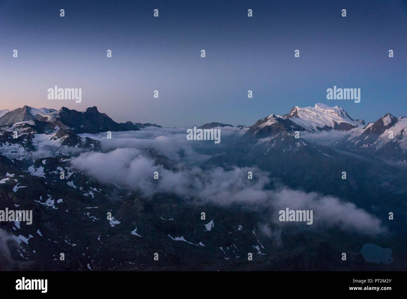 Switzerland, canton Valais, district Entremont, Verbier, sunrise, 3329 m high Mont-Fort, view on the Combin de Corbassière - Stock Image