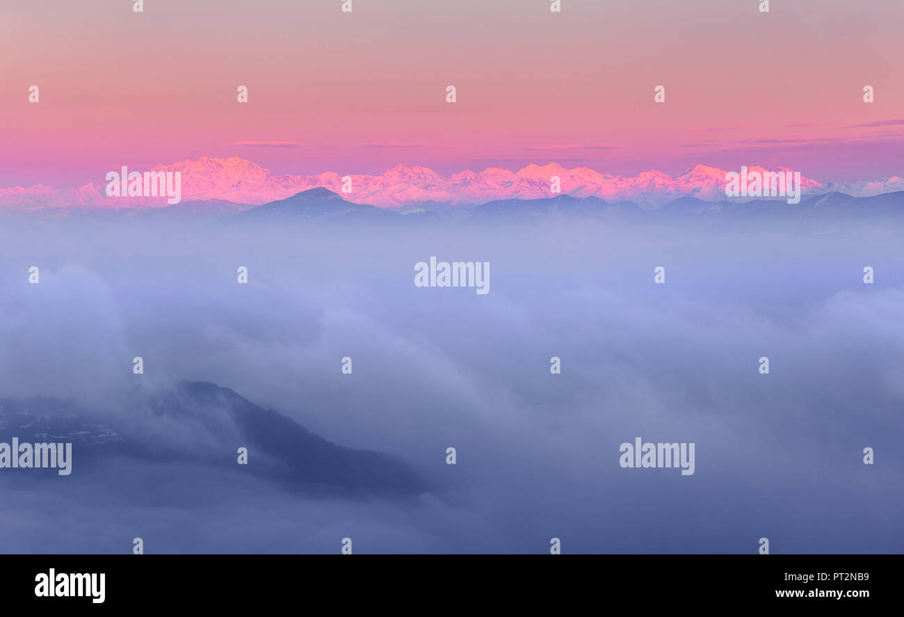 Rosa Mount and other peaks from alps rise up from a sea of clouds at sunrise, View from Brunate town (Como province, Lombardy, Italy, Europe) - Stock Image