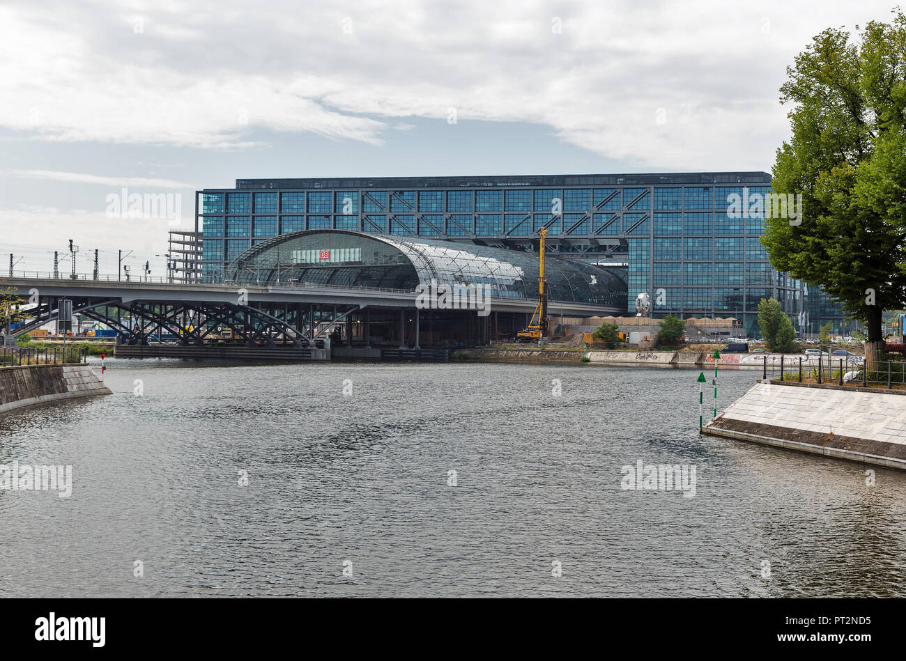 BERLIN, GERMANY - JULY 13, 2018: Westhafenkanal and Central Passenger Railway Station Hauptbahnhof. The station is operated by DB Station and Service, Stock Photo