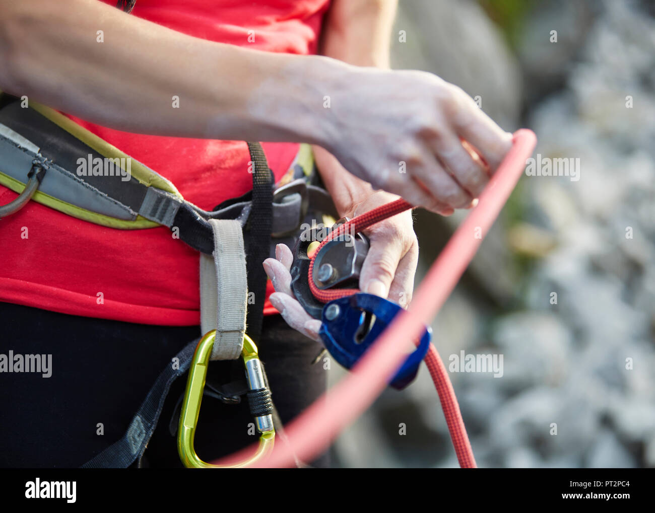 Close-up of female climber with climbing equipment - Stock Image