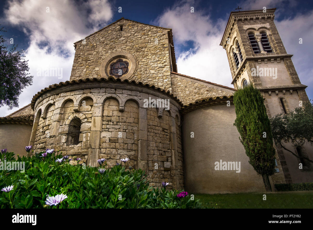 Built in the XI century. In 1851 the bell tower was built in neo-Romanesque style. The apse is cataloged as monument historique. - Stock Image