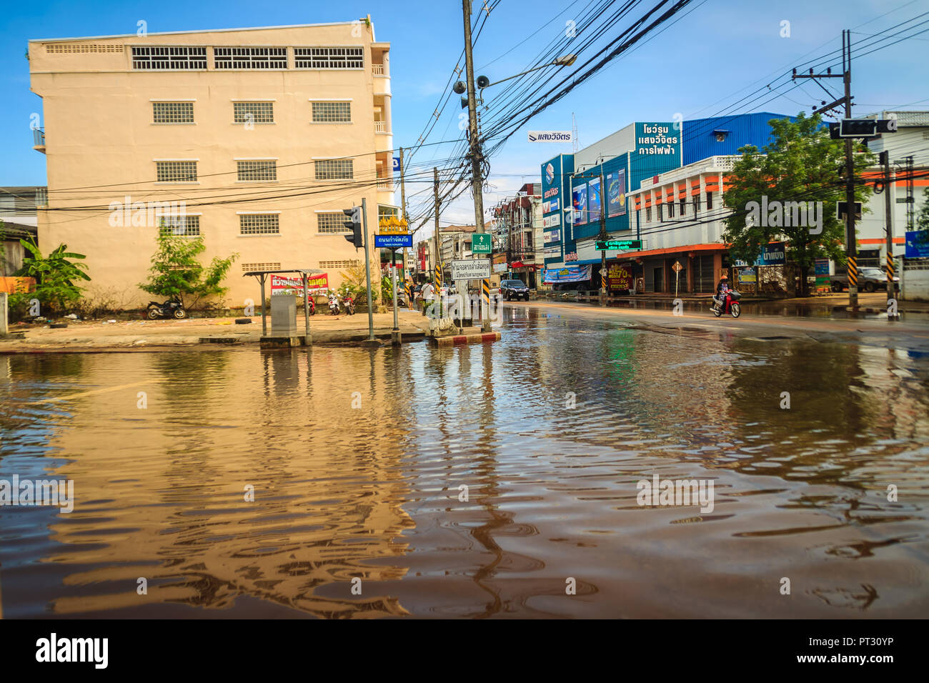 Sakon Nakhon, Thailand - August 4, 2017: Difficulty transportation in a heavy flooding situation in urban Sakon Nakhon, Thailand. The heavy flood in S - Stock Image