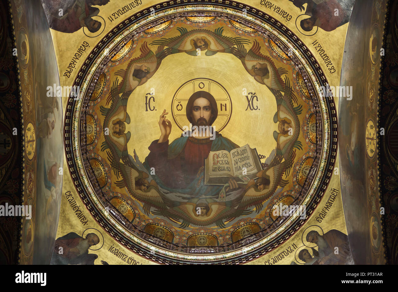 Jesus Christ depicted in the mural painting inside the dome of the Dormition Church on Vasilievsky Island in Saint Petersburg, Russia. The church designed by Russian architect Vasily Kosyakov with mural paintings by Russian painters Nikolay Strunnikov and others was built in 1895-1903. Stock Photo
