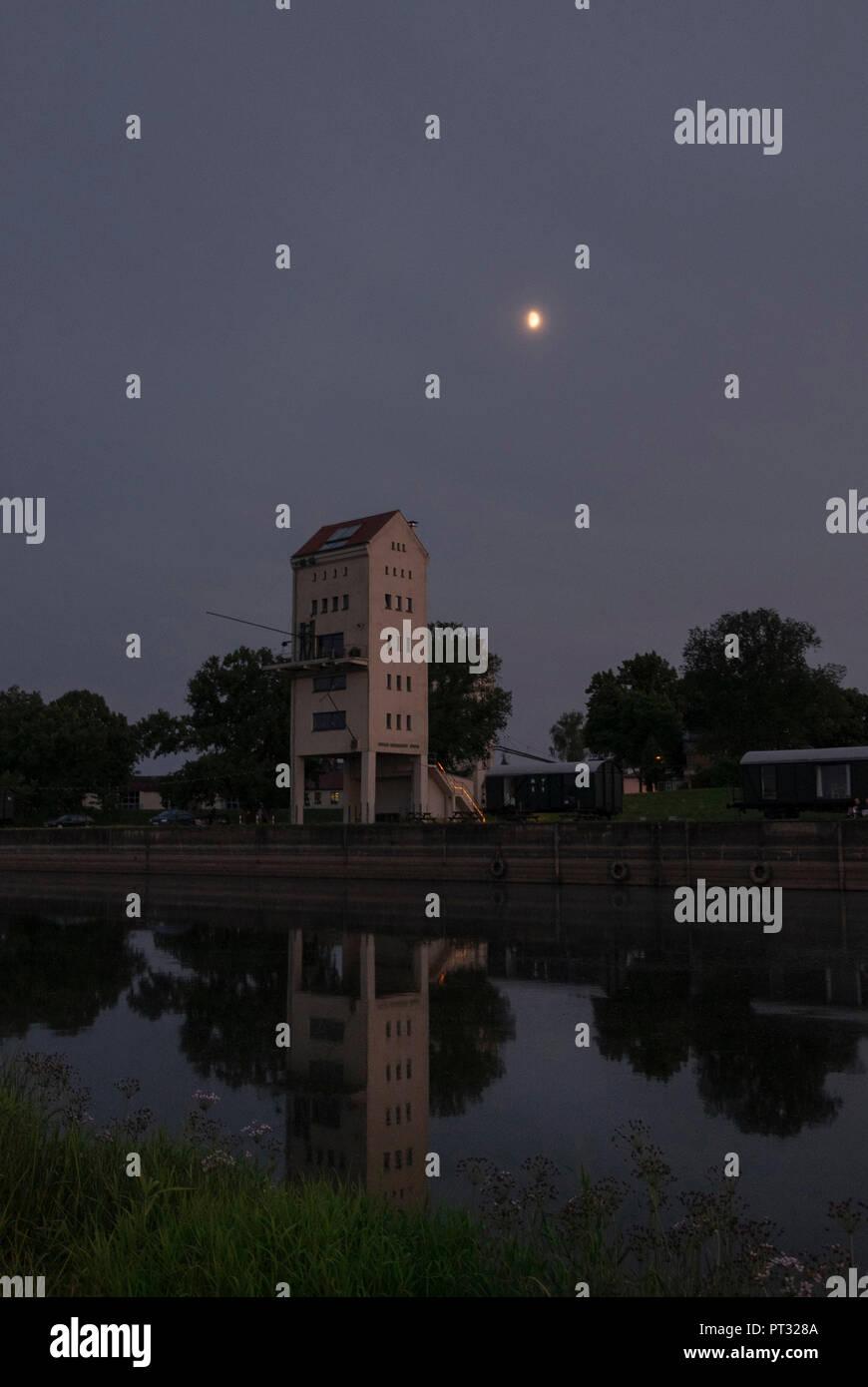 Kulturhafen Gross Neuendorf, loading tower, waggons, moon, Oderbruch, Brandenburg, Germany - Stock Image