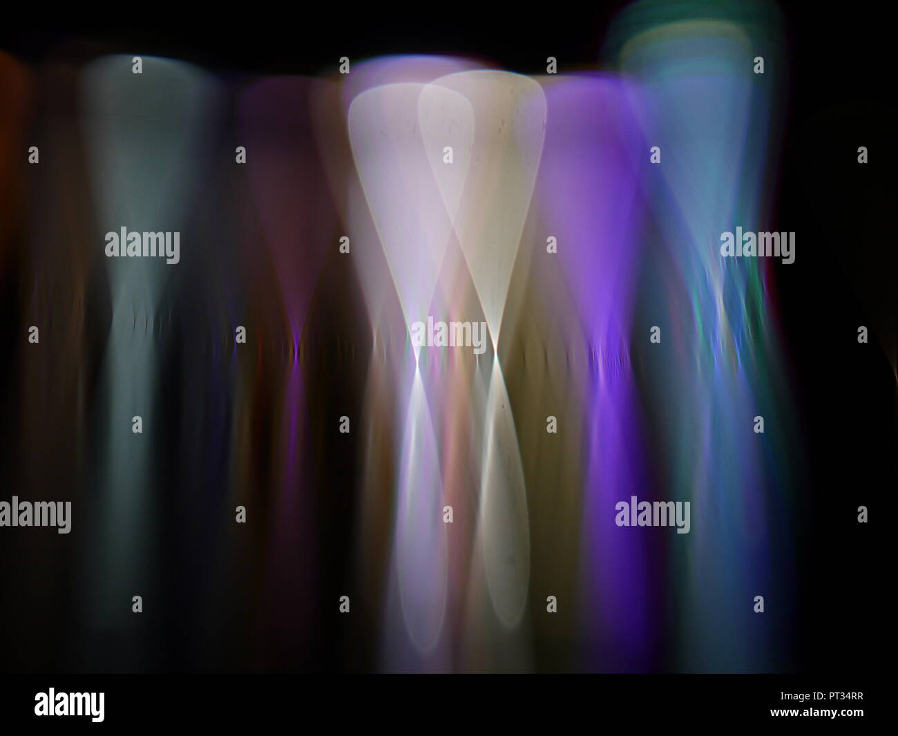 Graceful light shapes shimmering in a group. - Stock Image