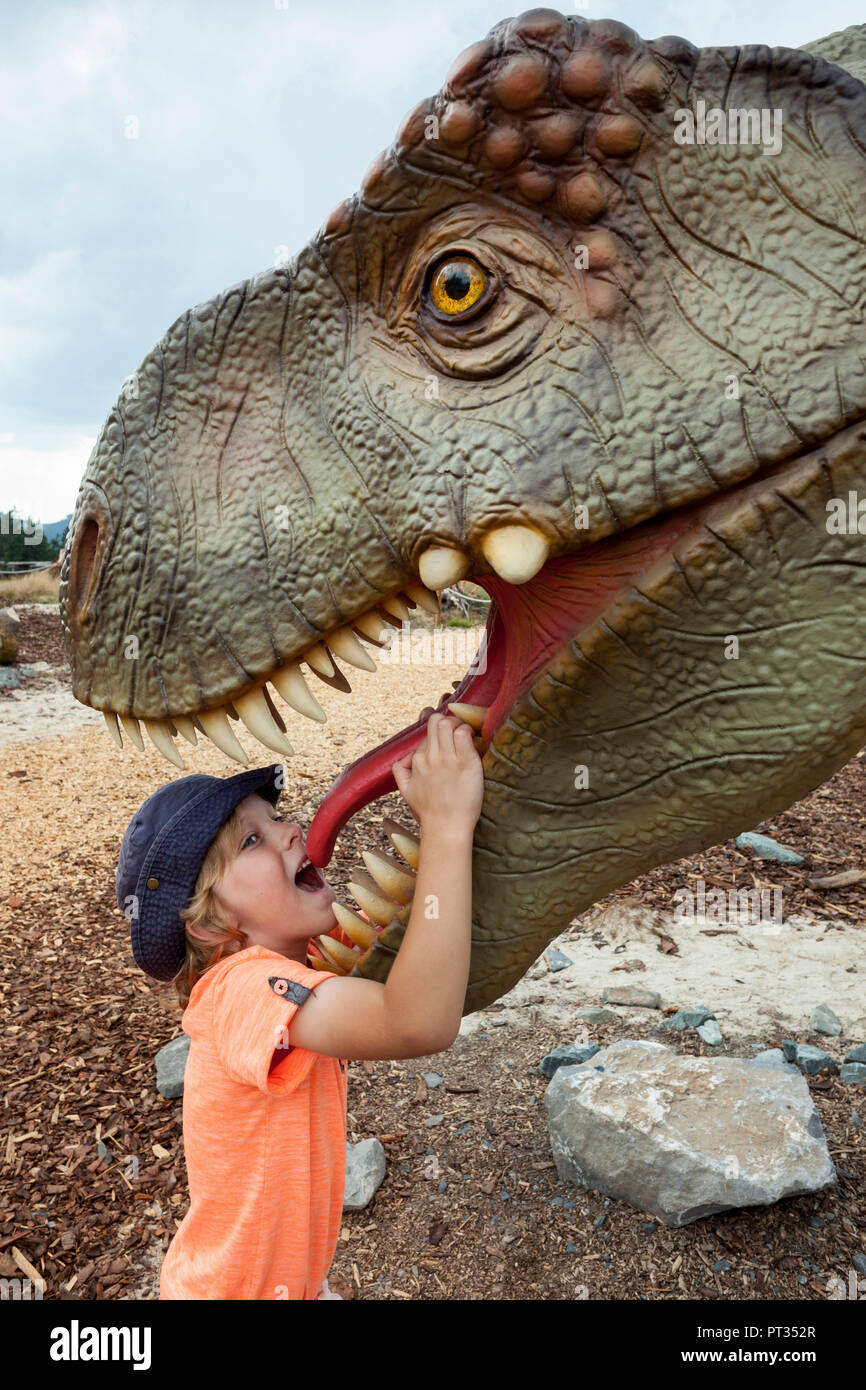 Boy and dinosaur - a fascination, Dinosaur exposition on Mount Stüppel, Adventure Park Fort Fun in the Sauerland (Hochsauerland) near Bestwig-Wasserfall, Germany, - Stock Image