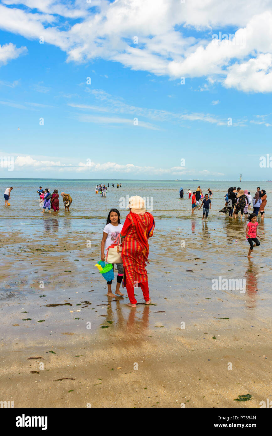 Muslim families enjoying a day out on the beach at Margate, Kent, England, UK - Stock Image