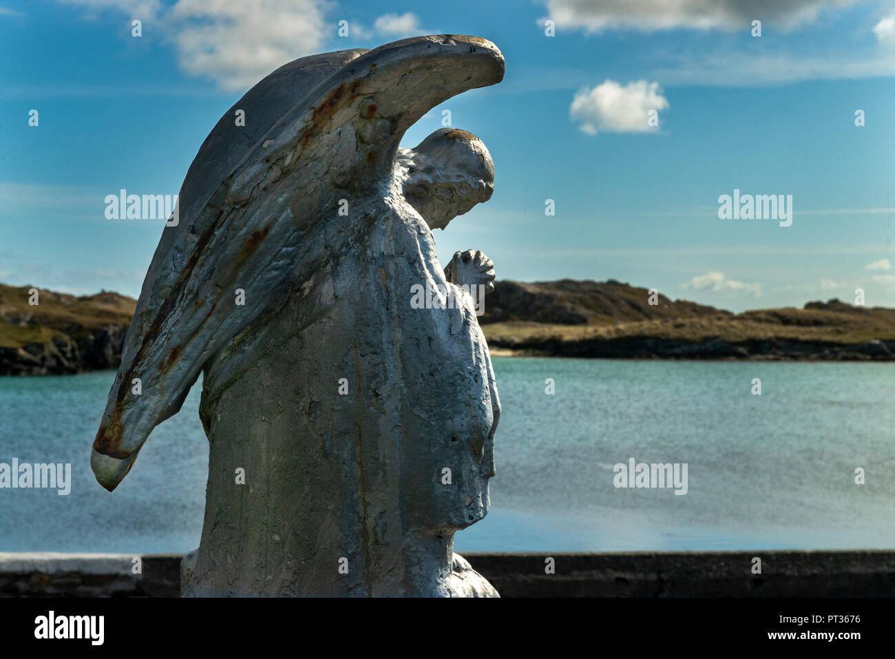 Angle praying, looking out  over the bay, Old fishing boast - IRELAND, Connemara, Inishboffin island, Inis Bo Finne (Island of the White Cow) - Stock Image