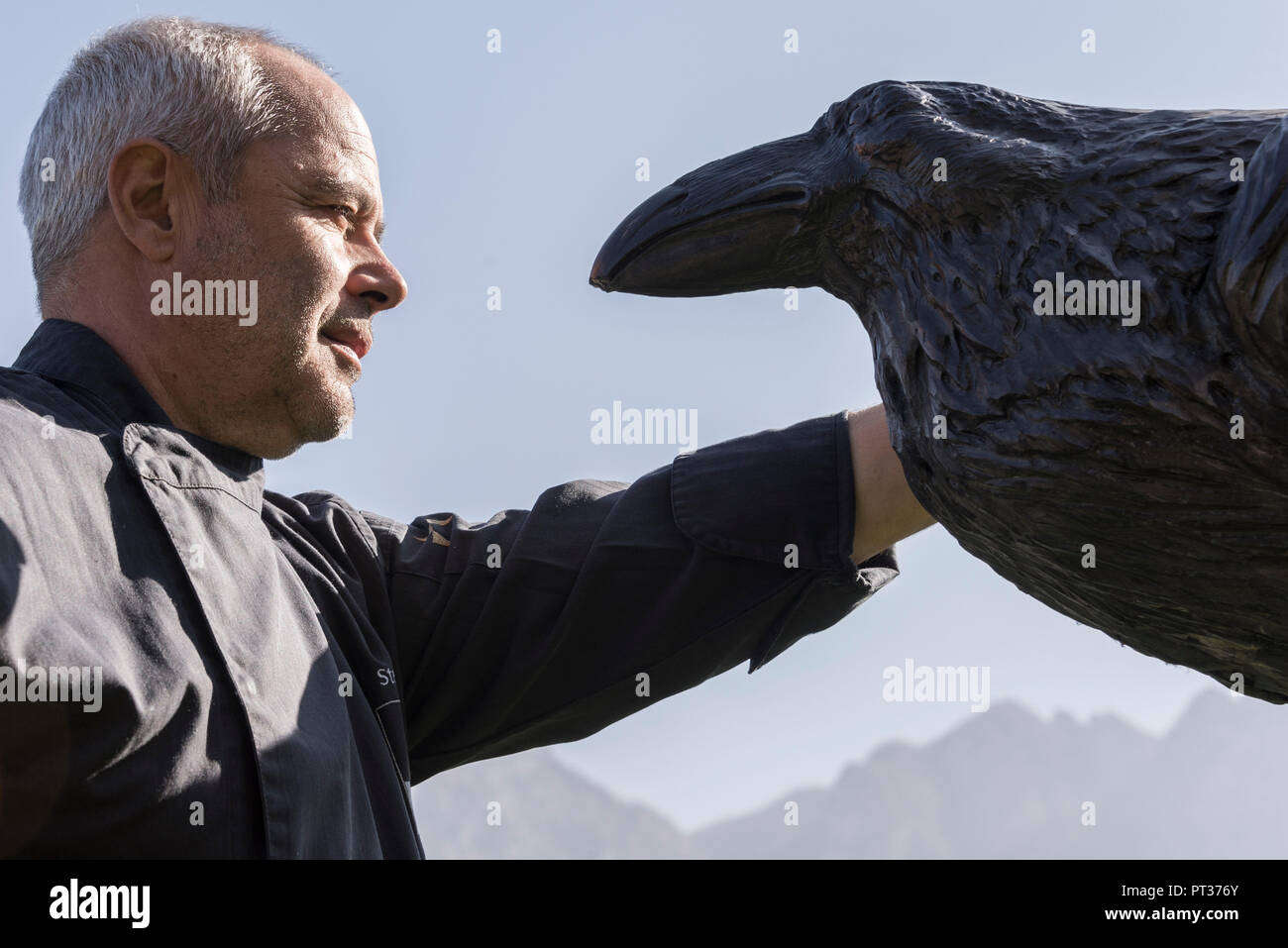 Stefan Pramstaller with raven figure, Romantik Hotel Turm, Fiè allo Sciliar, Alpe di Siusi, Eisacktal, South Tyrol, Italy - Stock Image