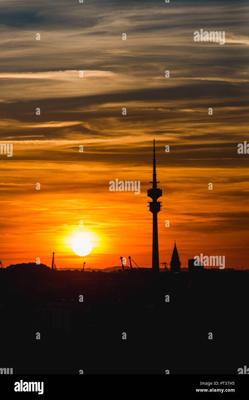 Sunset over Munich and the silhouette of the Olympic Tower - Stock Image