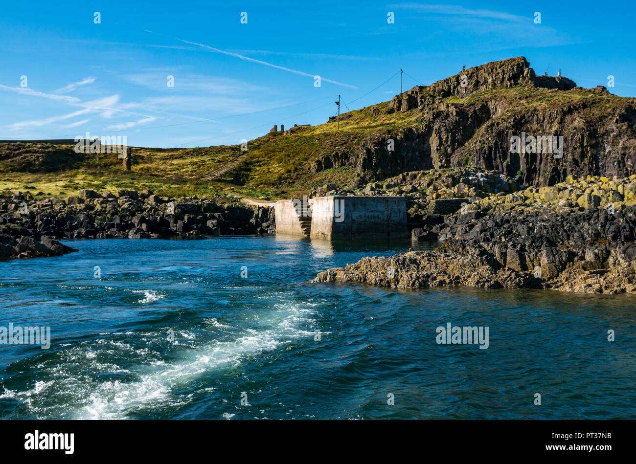 Wake of boat and landing pier, Fidra Island, Firth of Forth, East Lothian, Scotland, UK - Stock Image