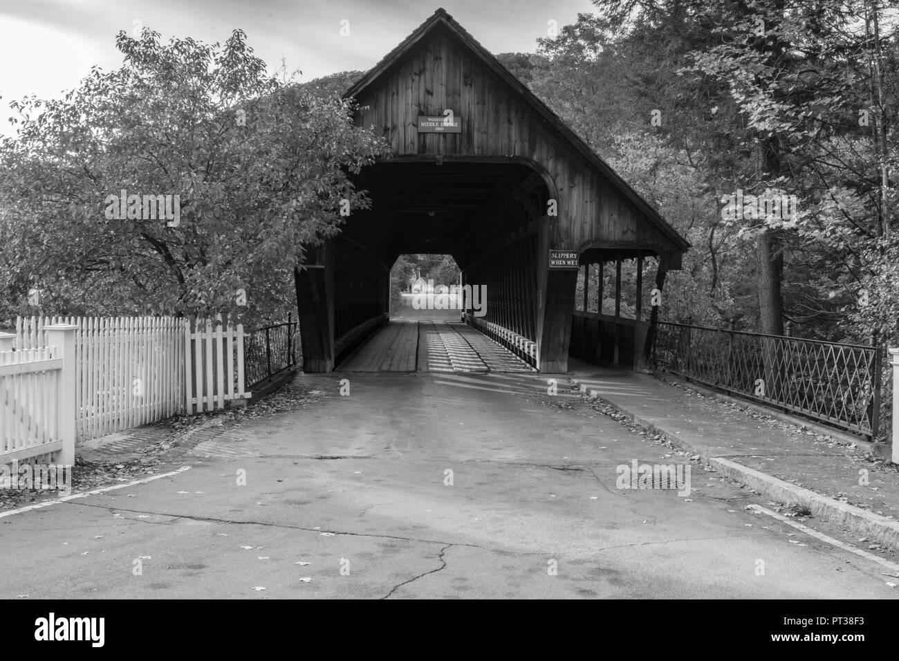 Black and white photo of a covered bridge in woodstock vermont