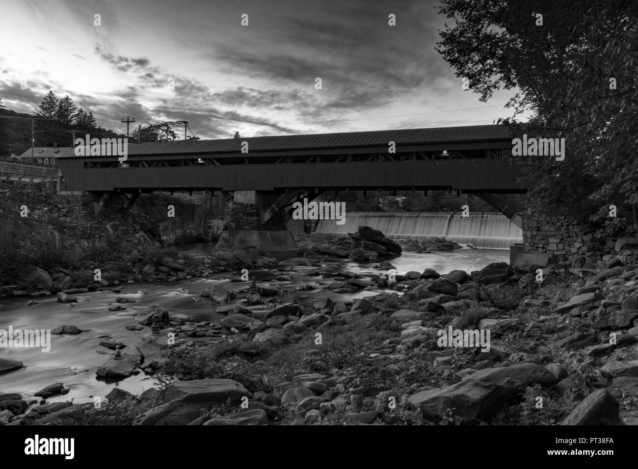 Black and white photo of the a covered bridge in woodstock vermont