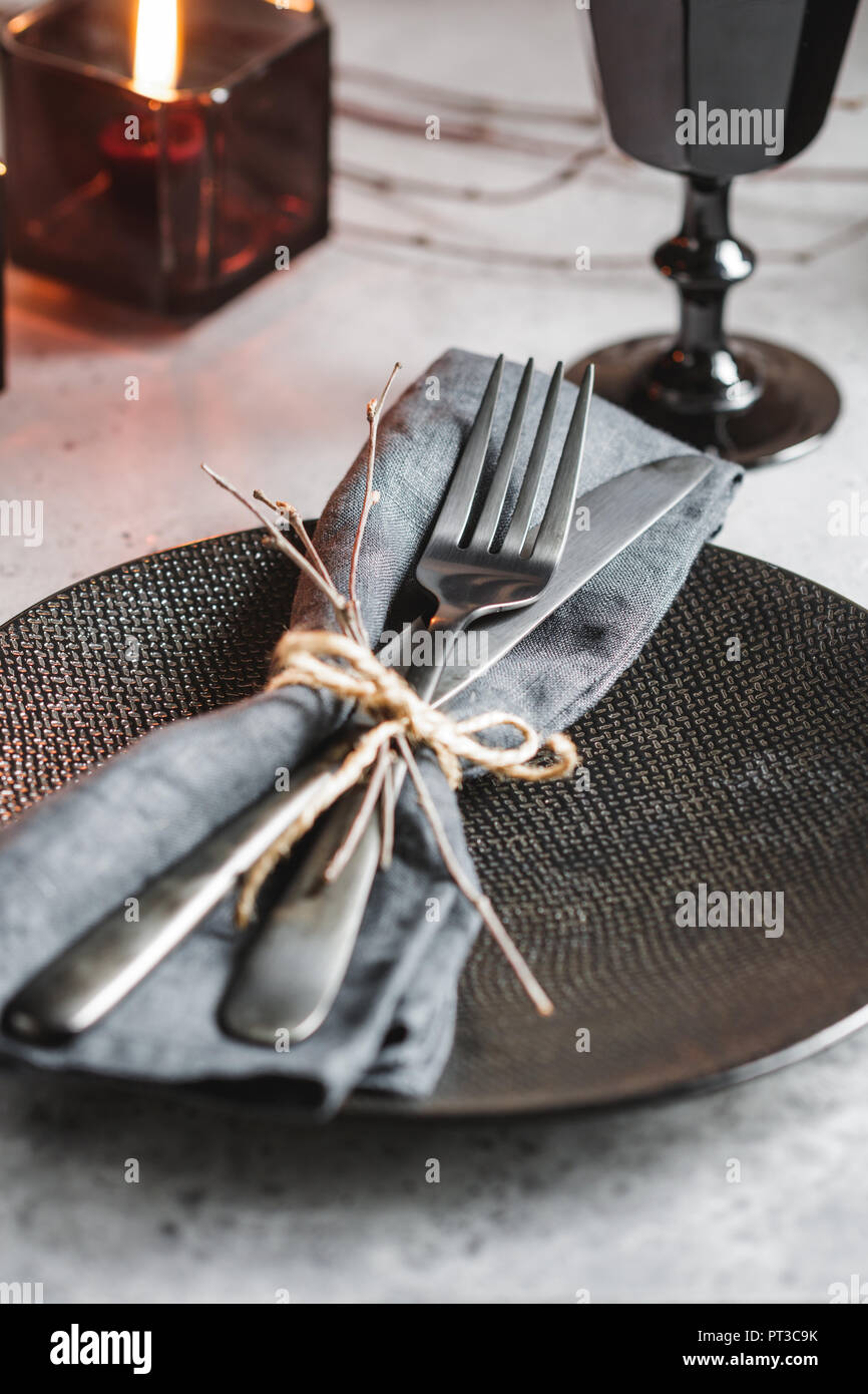 Festive Table Setting In A Black Style Among Black Candles On A White Table Plate With Fork And Knife On A Linen Napkin Thanksgiving Or Halloween Di Stock Photo Alamy